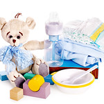 Baby diaper and toys with teddy bear .