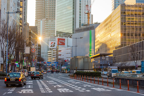 ōsakashi ōsakafu japan jp street urban downtown center cityscape city evening midtown district view building traffic transport public buildings photo photograph central area cars road sign signs hotel overview office architecture sunset signage lights taxi sun beam