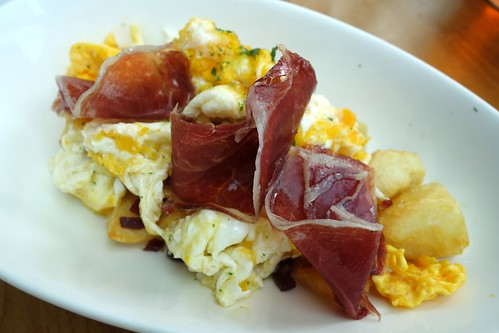 Paletilla - Estrellados at Catalunya Sunday Brunch. Scrambled eggs with Iberian Shoulder Ham