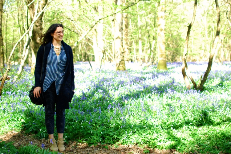 chambray and curls wearing all blue among the bluebells