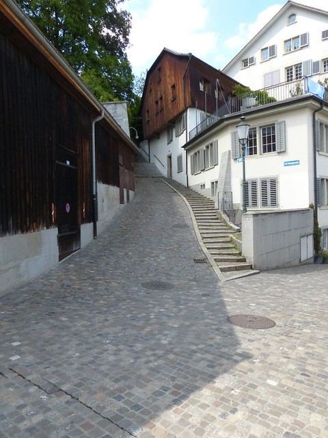 Cobblestones, Stairway and Wooden Home