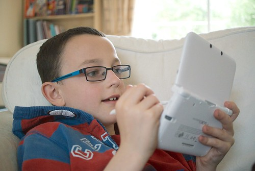 Birthday boy playing on his new 3DS XL