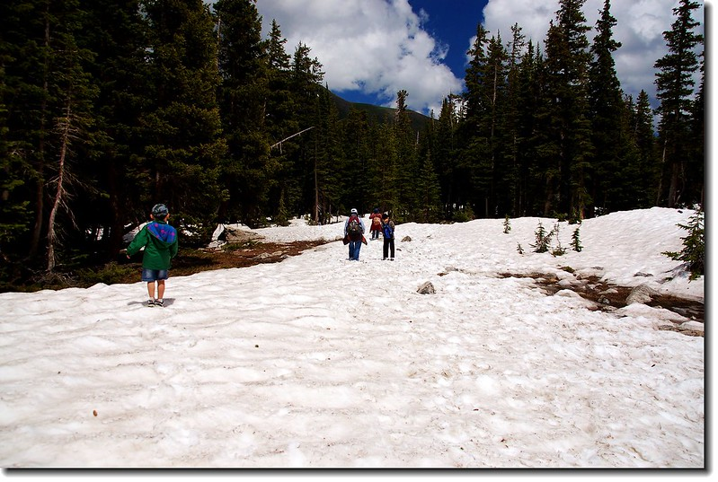 The trail to the lake was still covered in snow 1