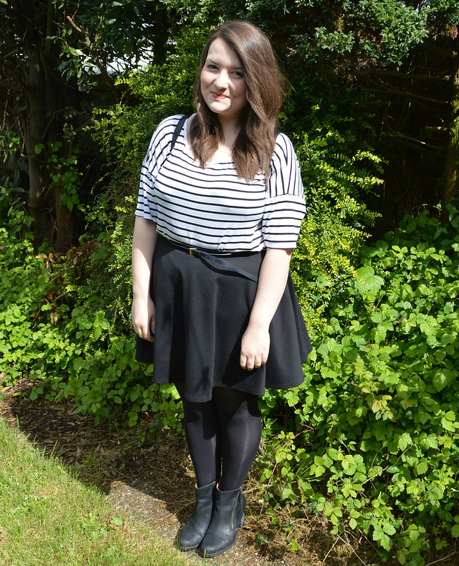 This is a picture of a boohoo plus striped t-shirt.