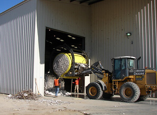 Picture of loading up round bales of cotton.