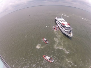 Coast Guard response boats from Station Tybee Island, Georgia, ferry rescued passengers and crewmembers from the grounded casino boat Escapade near Tybee Island Wednesday, July 16, 2014. Coast Guard members aboard three 25-foot response boats and one 45-foot response boat from Station Tybee Island worked together to ferry 114 people from the grounded casino boat to the Coast Guard Cutters Maria Bray and Tarpon, which are larger vessels capable of carrying more people than the smaller response boats, and two Coast Guard helicopters hoisted four additional people off the casino ship. (U.S. Coast Guard photo)