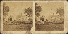 Unidentified family pictured with farmhouse, barn, and pasture
