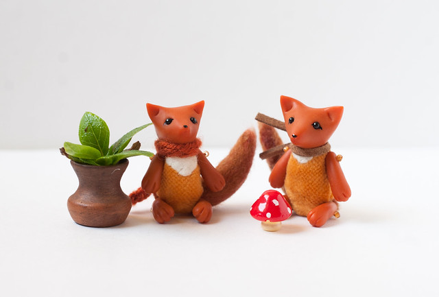 tiny foxes with toadstools