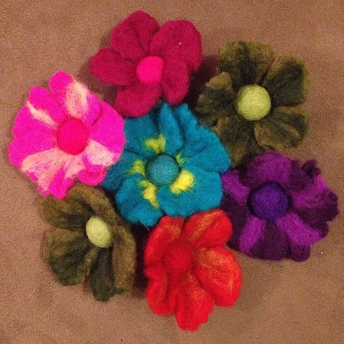 A little bouquet of felted flowers. Wet felt for the petals, needle felted in the centre to hold them onto the bobby pins at the back.