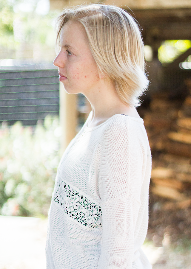 short blonde hair, self-portrait in profile, see-through cream lace sweater