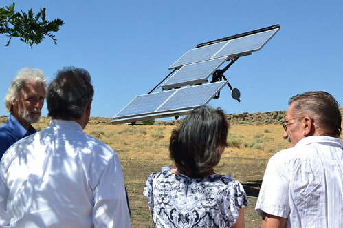 Mark Snyder, Tony Hernandez and the Schulers check out the solar array.