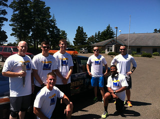 Coast Guardsmen from Coast Guard Station Siuslaw River in Florence, Ore., prepare for the start of their leg of the Law Enforcement Torch Run in Florence, July 10, 2014. Participants ran the Flame of Hope torch from the Oregon-California border to Depoe Bay, Ore., to raise awareness for the Special Olympics. U.S. Coast Guard photo.