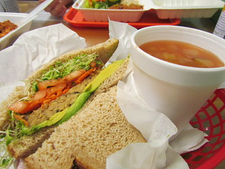 Tempeh Burgery with Avocado and a cup of Vegetable Soup at Ruffage