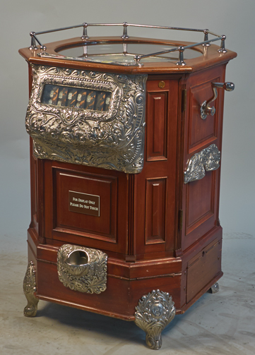 615.01 25 Cent Caille Roulette Floor Machine, an early model w/ mahogany case in working condition c1904, w/Keys