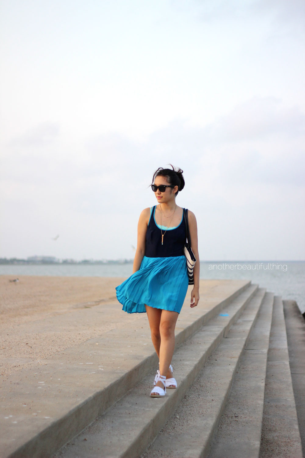 Ladylike beach outfit: Navy and turquoise dress and white espadrilles