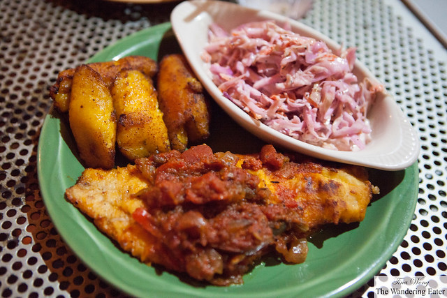 Sautéed catfish with a side of coleslaw & roasted plantains