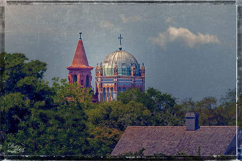 Image of a spire on Flagler College and the cupola on the Flagler Presbyterian Church