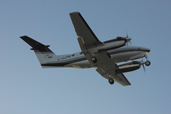 Beech King Air B200, G-CLOW, about to touch down on runway 07 at Newcastle Airport - 19/04/14...