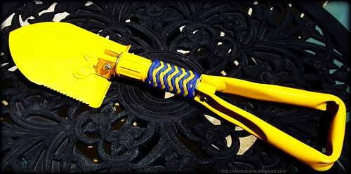 Folding shovel with paracord pineapple knot...