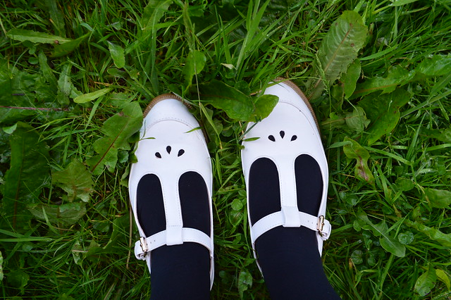 photo of white shoes with a buckle