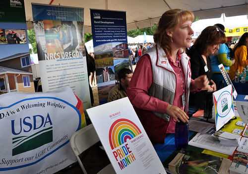 Lissa Biehn (left) with FSA and Ramona Mitchell, Rural Development, discuss USDA's dedication to civil rights in employment and program delivery at the Northwest Pride Festival in Portland, OR, on June 14.
