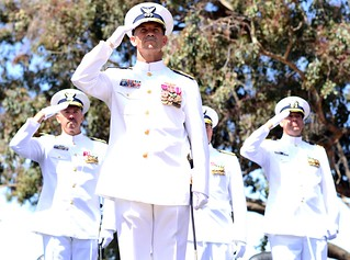 Vice Adm. Charles W. Ray, the Pacific Area Commander, and the official party render a salute during the opening of the 11th District change of command ceremony held on Coast Guard Island in Alameda, Calif., Thursday, June 5, 2014. Rear Adm. Joseph A. Servidio took command from Rear Adm. Karl L. Schultz, who has served as the district's commander since July 2012. U.S. Coast Guard photo by Petty Officer 3rd Class Adam Stanton
