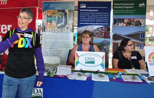 A USDA alumna (left), who attended the Northwest Pride Festival with her partner and their two children, stopped by to let us know how happy she was to see USDA reaching out to the LGBT community.