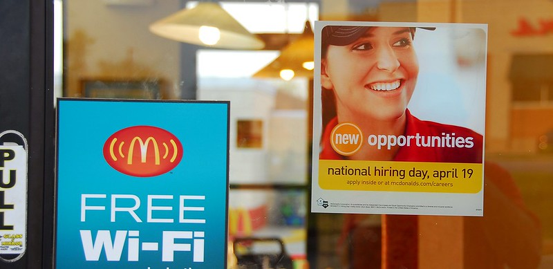McDonald's National Hiring Day sticker on a franchised restaurant
