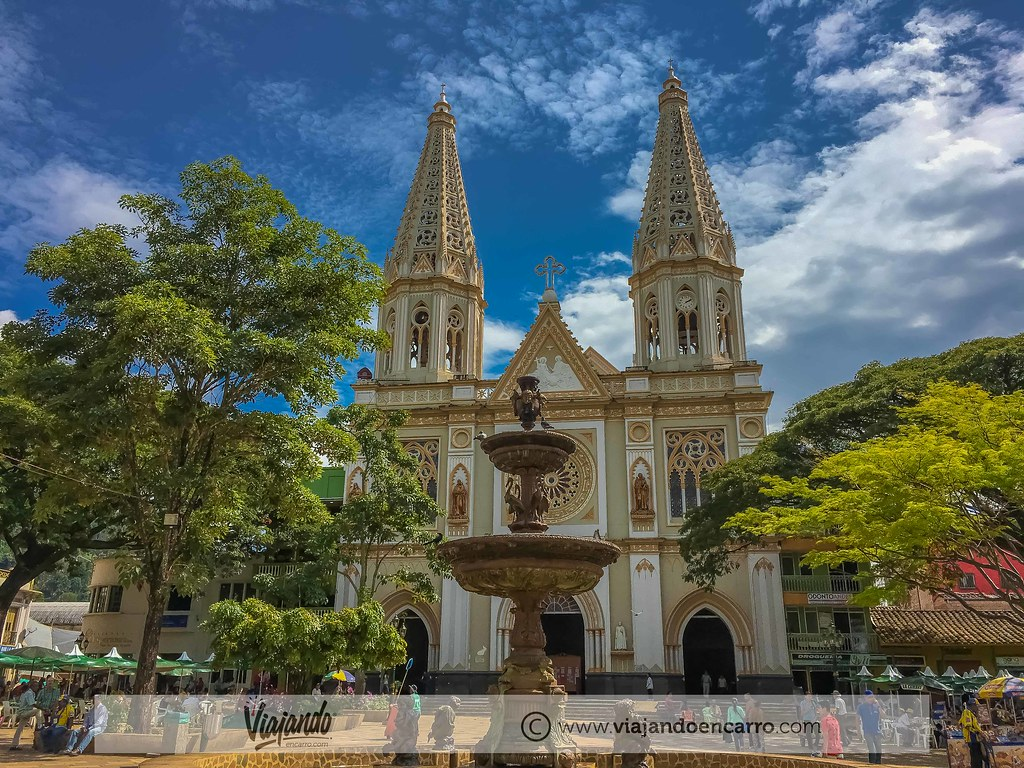A beautiful square in the town of Andes in Antioquia with the Nuestra Señora de las Mercedes church and a nice fountain.