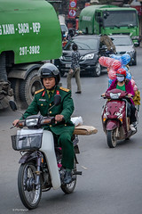An officer and a balloon salesperson - Hanoi traffic