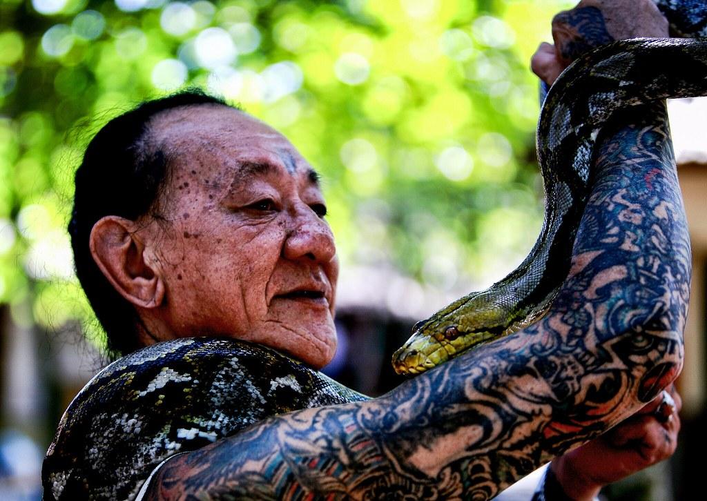 A Balinese Man & His Python