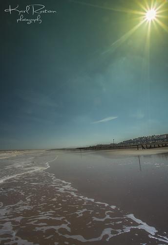 ocean sky sun beach water clouds landscape coast seaside sand waves outdoor shore withernsea