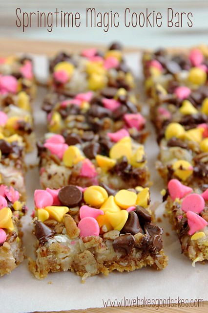 Springtime Magic Cookie Bars are a soft baked graham cracker cookie bar topped with coconut, pecans and Springtime morsels! #cookie #bars #coconut #chocolate