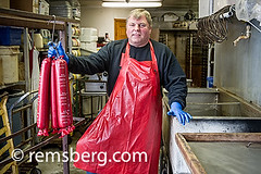 Man standing next to freshly made baloney.Frostbur…