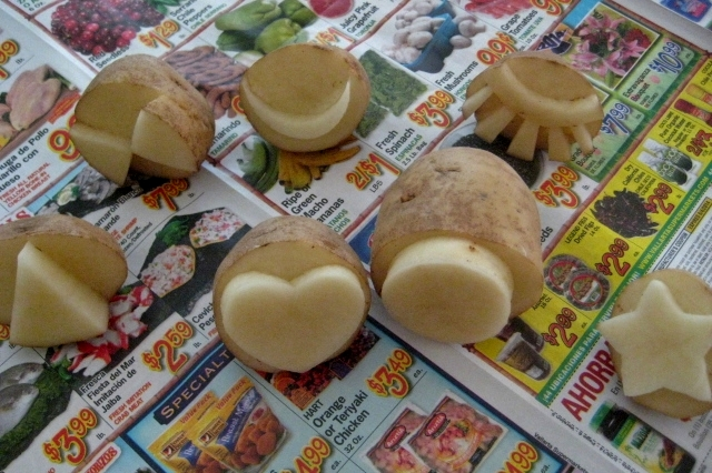 silly faces made from potato stamps