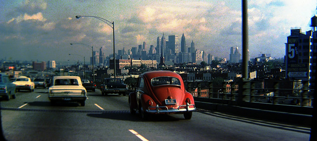 Cruising the highways of Brooklyn in my dad's 1953 Pontiac Chieftan. Old brownstowns on the street at right and the towering skyline of Lower Manhattan in the distance. New York. Aug 1969