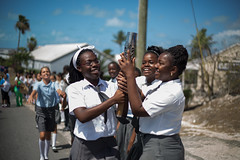 Schoolchildren enjoy holding the Queen's Baton, in Grace Bay, Turks and Caicos Islands, Wednesday 16 April 2014. Turks and Caicos Islands is nation 56 of 70 nations and territories the Queen's Baton will visit....