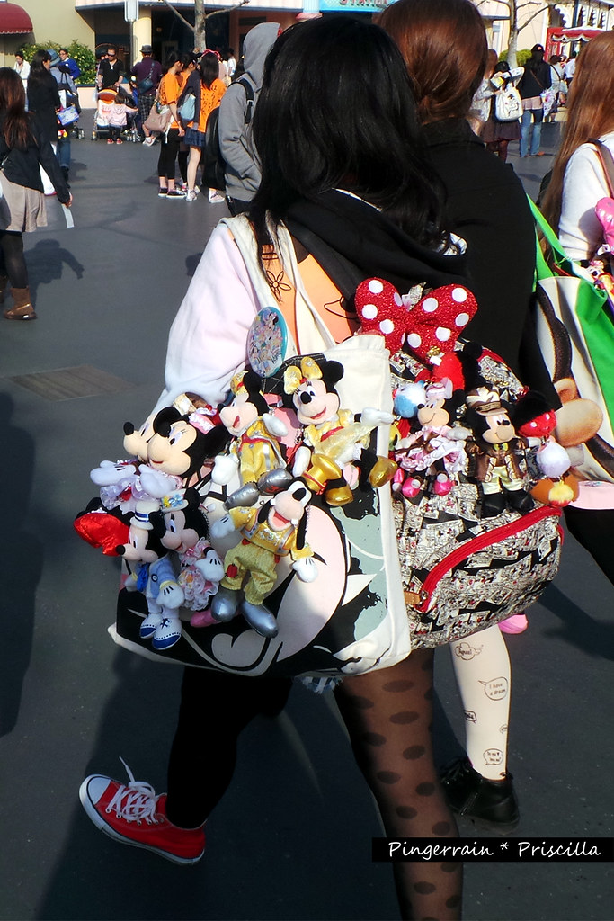 Girl with her bag full of Mickey and Minnie