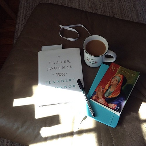 Coffee, sunlight, journal, prayers & my first time reading Flannery O'Connor #hellomorningcoffee