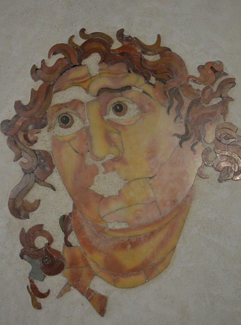 Head of Helios in opus sectile, from the Mithraeum of Santa Prisca on the Aventine, 1st half of the 3rd century AD. Roman National museum, Palazzo Massimo alle Terme