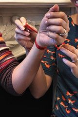 Tying Brazilian wish ribbons IMG_1471 R