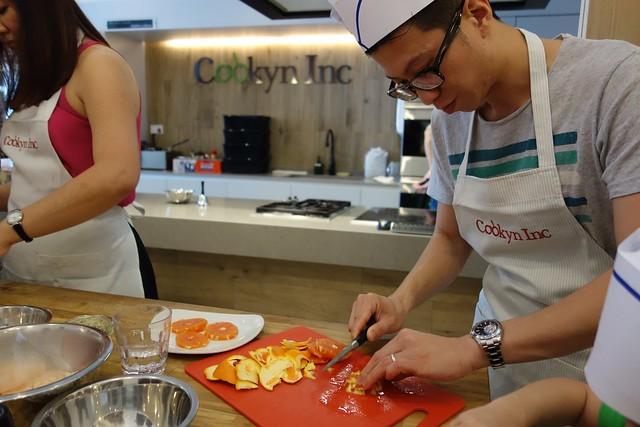Der hard at work at peeling & cutting the Cara Cara Oranges.