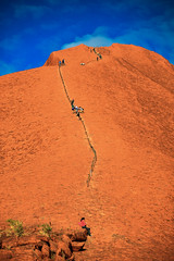Climbing up to the peak of Ayers Rock