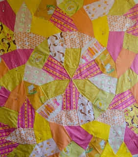 I've quilted the center star (my brain yells 'it's an asterisk!') and I'll work outward from there to avoid quilting any bubbles into the backing.  This quilt is based on a Hirschhorn tiling. Details of the quilt, 'Sunshine,' are at domesticat.net/quilts/sunshine