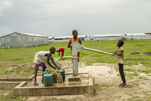 Refugee girls, Nya Panom Makal, Nya Choul Makal and Nayakhor Gatluack pumps water at Burbie Refugees Reception Centre