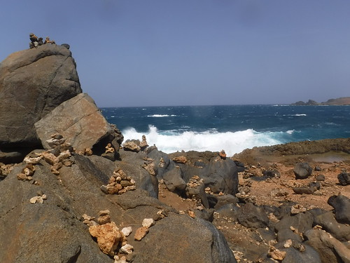 aruba coast surf rugged dangerous waves inukshuk natural stone bridge rock inuksuit