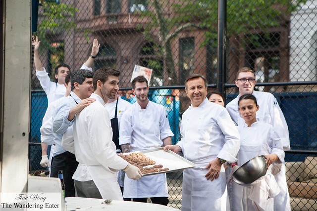 Chef Daniel Boulud (on the right holding the sheet pan) and his team