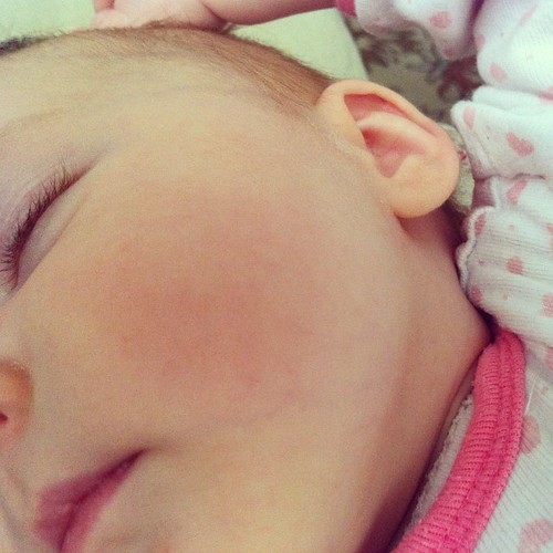 """this baby.  every morning her big sister wakes us up by asking to hold her. she's """"talking"""" and smiling all the time. we are finally falling into a bit of a daily rhythm. there's more sleep and less spit-up. we made it to three months, Lucy!"""