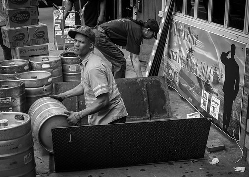 In street photography you have to always be ready to shoot. In this case I noticed the Fleet Week sign and the man loading kegs as I walked by. I quickly turned and got off about a dozen frames before I moved on. 1/125, f5.6 at ISO 500.