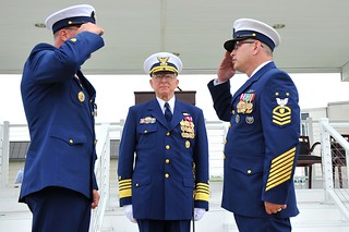 Master Chief Petty Officer Steven W. Cantrell (right) assumes the duties of the master chief petty officer of the Coast Guard during a change-of-watch ceremony Thursday, May 21, 2014 at Coast Guard Training Center Cape May, N.J. During the ceremony, overseen by Coast Guard Commandant Adm. Robert J. Papp Jr., Cantrell relieved Master Chief Petty Officer of the Coast Guard Michael P. Leavitt to become the 12th MCPOCG. U.S. Coast Guard photo by Petty Officer 2nd Class Patrick Kelley.